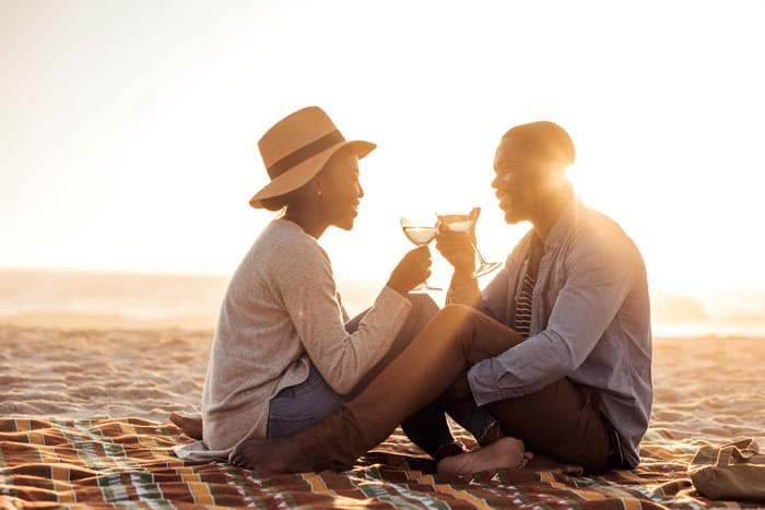 couple flirting during a romantic date on the beach